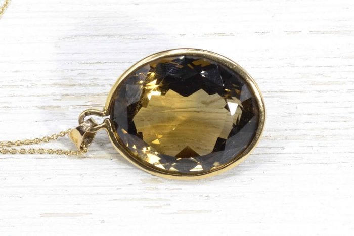 Smoky quartz pendant necklace in yellow gold