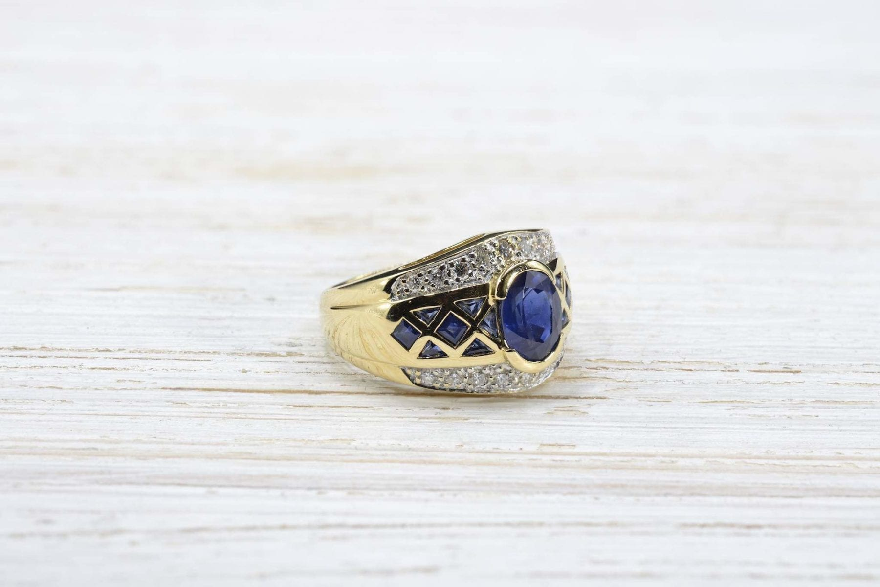 calibrated sapphire and diamonds ring