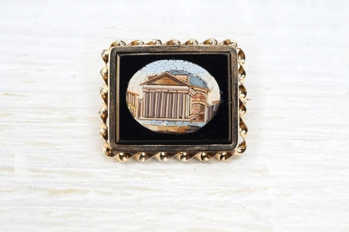 Antique onyx and mosaic brooch