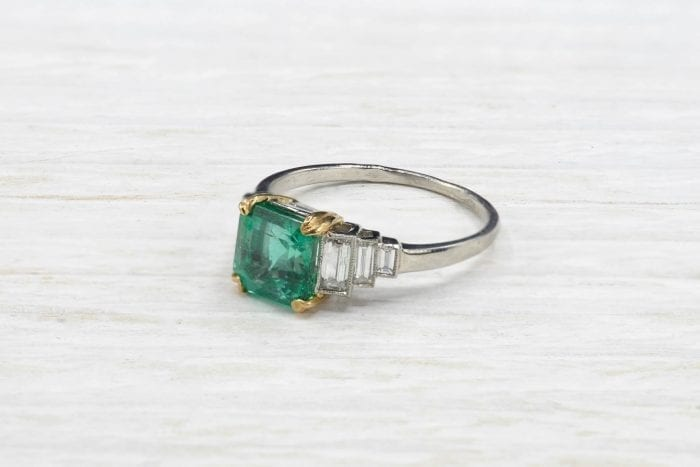 Emerald ring with baguette-cut diamonds