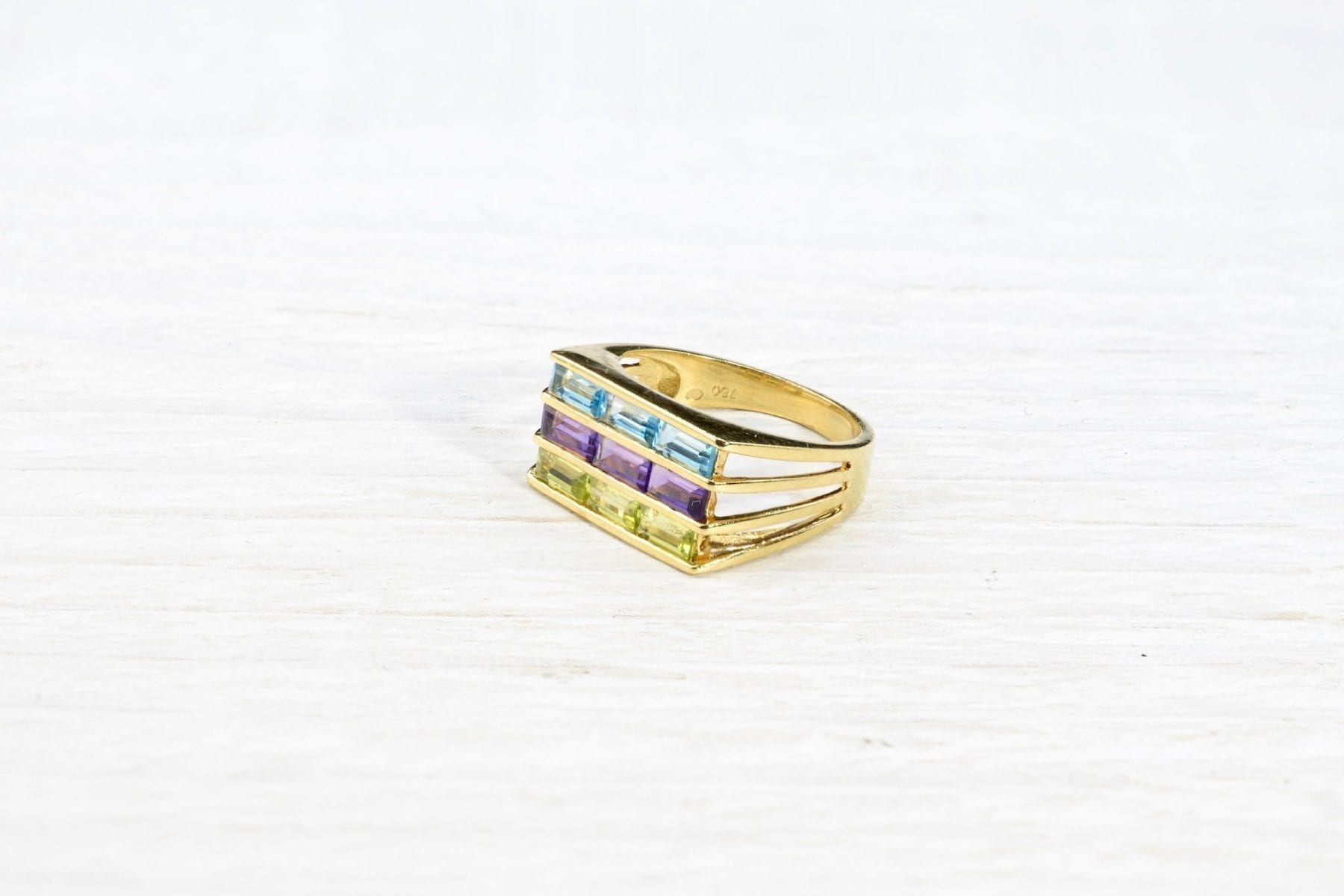 fine stones and gold ring