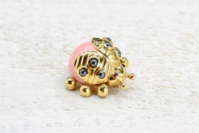 Coral ladybug brooch in 18k yellow gold