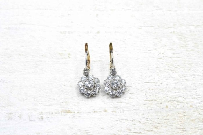 Platinum diamond earrings in 18k gold