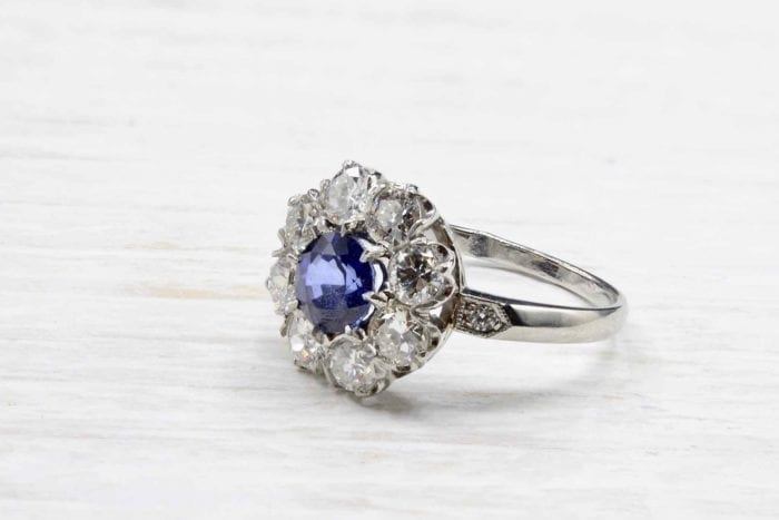 Sapphire daisy ring with platinum diamonds