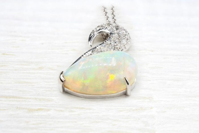 Opal pendant in 18k white gold and antique diamonds