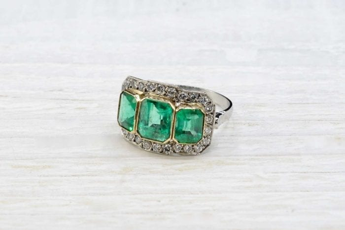 Trilogy emeralds ring with diamonds