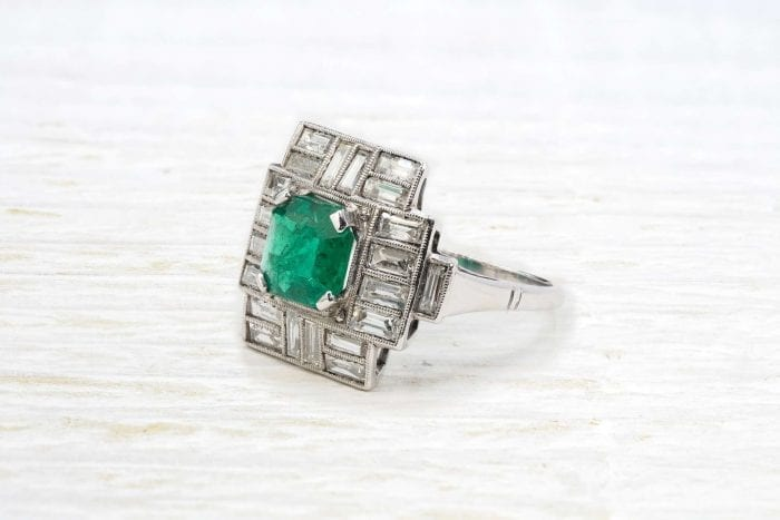 Emerald ring with baguette-cut diamonds in platinum