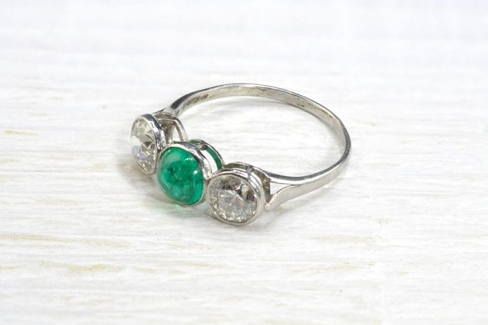 Emerald cabochon trilogy ring with platinum diamonds