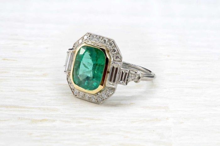 Natural emerald ring with diamonds