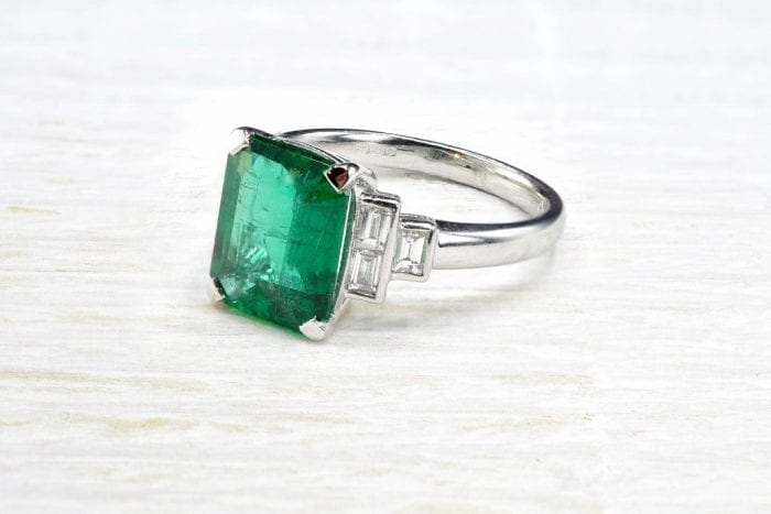 Natural emerald ring with diamonds in 18k white gold