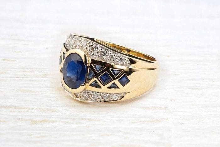 Sapphire braces ring in 18k yellow gold