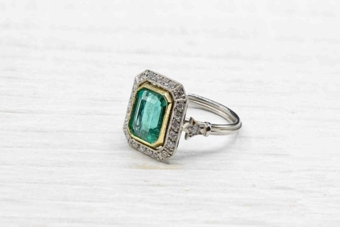 Emerald ring with vintage platinum diamonds