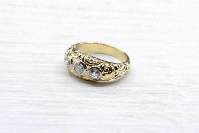 18K yellow gold three-diamond ring