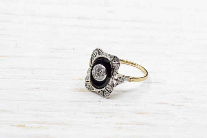 Antique onyx ring with platinum diamonds in 18k yellow gold