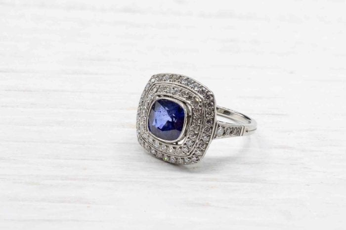 Platinum diamond double surround sapphire ring