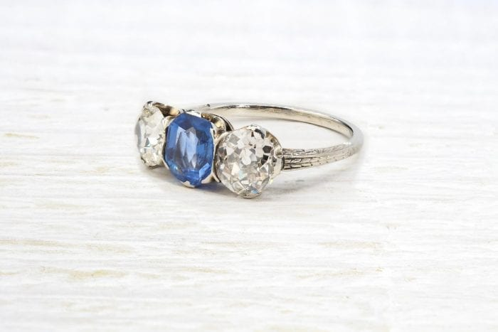 Platinum diamonds and sapphire trilogy ring