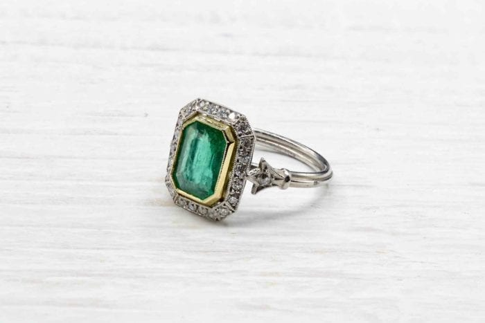Emerald ring with platinum diamonds
