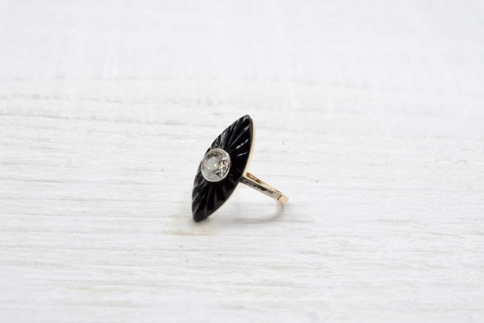 Onyx and diamond shuttle ring in 18k yellow gold