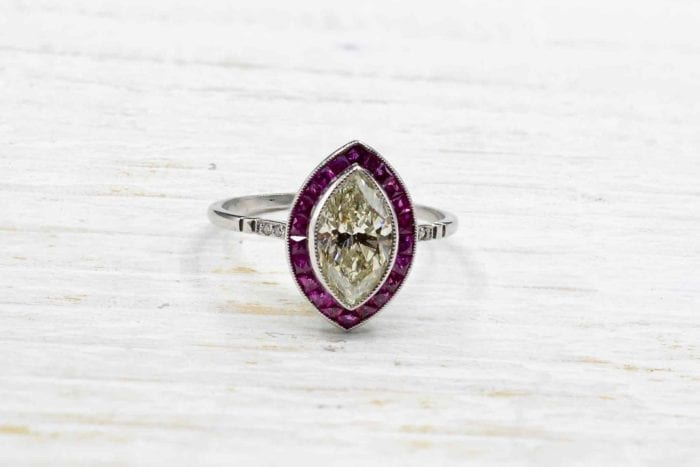 Natural diamond and ruby shuttle ring in platinum