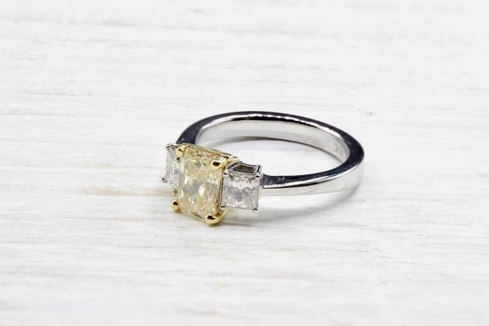Solitaire yellow diamond ring in white gold