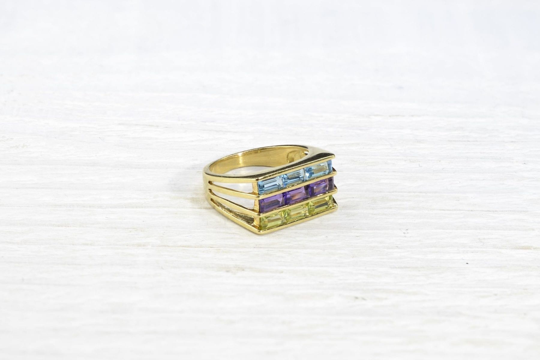 yellow gold ring with fine stones